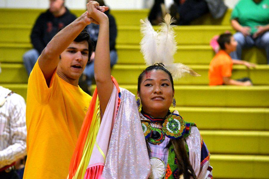 Senior Kyle Baldauf dances with Miss Northern Cheyenne Devin Kills Bac at the Morning Star Powwow on Saturday, Jan. 14.  The Morning Star Powwow, which is the largest powwow in the mid-Atlantic region, is an annual event held at JC to raise money for St. Labre Indian School.
