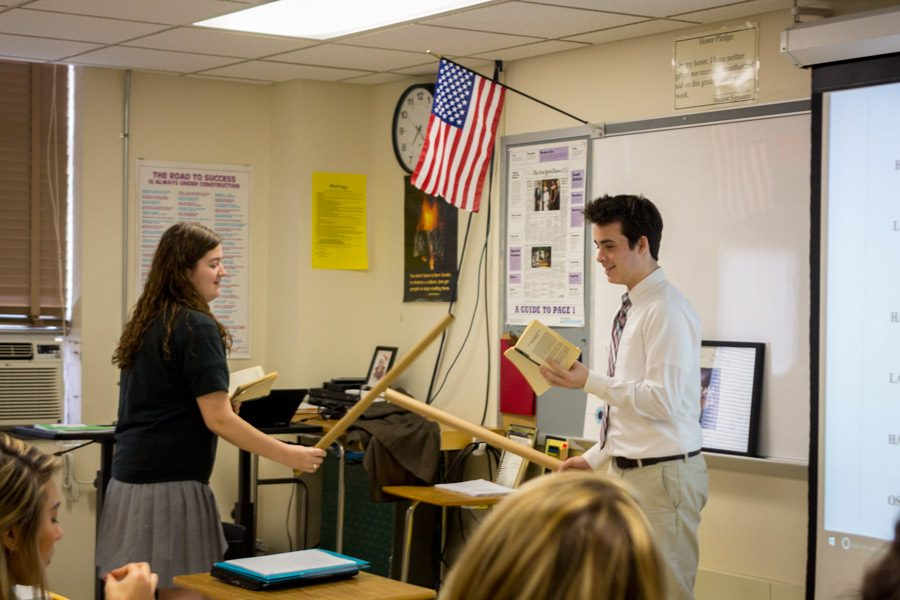 Seniors Carly Schofield and Grant Sharretts spend English class acting out the fencing scene in Shakespeares tragedy, Hamlet. Different main scenes of the play were preformed during other classes.