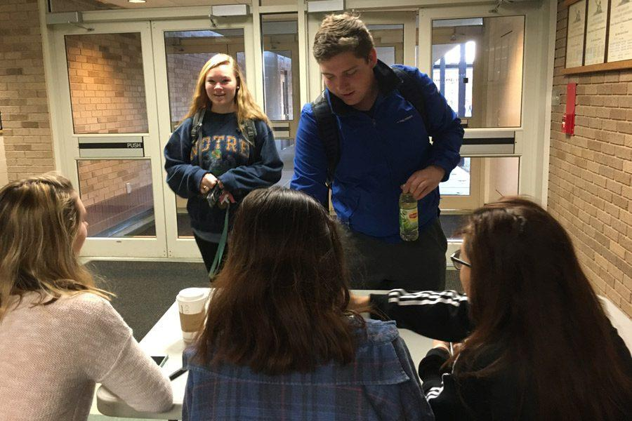 Senior Garrett Hefner purchases a bracelet in order to participate in a dress down day hosted by The Breakfast Club on Friday, Jan.13. A total of $1,126 was raised and donated to To Write Love on Her Arms, an organization raising awareness for suicide prevention.