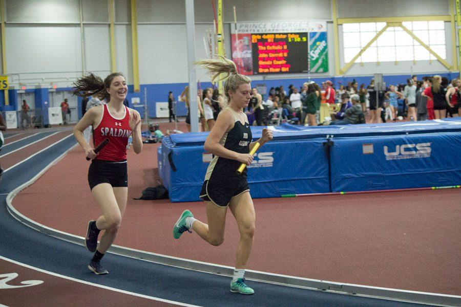 Junior+Hadley+Leishman+races+around+the+track+during+her+leg+of+an+800+meter+relay.+The+women%27s+indoor+track+team+competed+in+an+IAAM%2FMIAA+meet+at+PG+Center+on+Jan.+6+and+placed+15+out+of+37+teams+with+a+score+of+52.5.