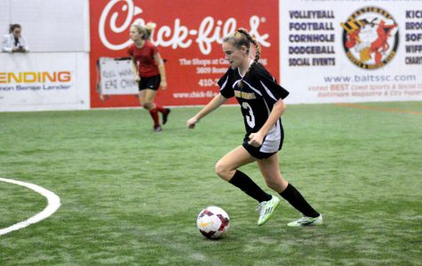 Senior Abby Hormes dribbles the ball in a game against Friends School on Friday, Jan. 20. The women's indoor soccer team finished the regular season with a final record of 7-2-2, and won the IAAM A Conference Championship on Friday, Feb. 4.