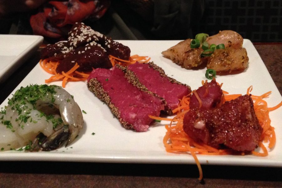 The Melting Pot is a fondue-style restaurant and offers different types of cheese, broth, and chocolate.  Pictured above is one of their raw meat entrees.