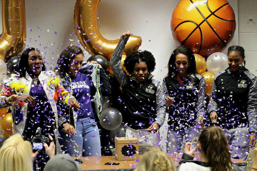 Junior point guard Savannah Simmons unveils her choice to commit to Kansas State University with the help of members of the women's basketball team. Simmons chose Kansas State due to its strong coaching staff, academics, and location.