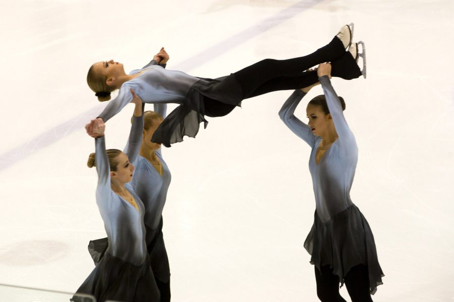 Members of the Chesapeake Sailors lift senior Beth Sapitowicz during a performance. Sapitowicz started ice skating competitively when she was only nine years old.