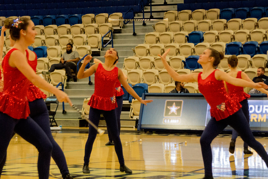 """Boeren throws and prepares to catch her baton. The team also performed their routine at the Presidential Inaugural """"Voices of the People"""" Welcome Concert on Jan. 19."""