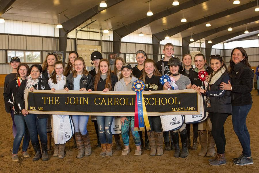 Members of the equestrian team pose with their awards after winning the IEA Zone 3 Regional Finals on Feb. 19. In addition to the team's success, individuals placed in various classes on Feb. 18.