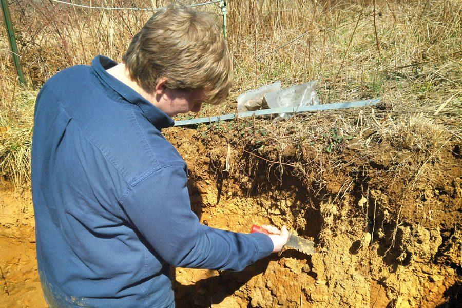 Senior Caleb Olsen investigates soil layers at the Spring Envirothon Training held on Wednesday, March 29 at Harford Glenn. The team traveled to the event in preparation for their competition on April 11 and attended seminars on soil science, aquatics, forestry, and wildlife.
