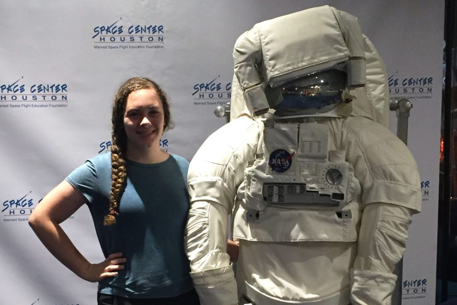 Sophomore Gabrielle Lambert poses with an astronaut figure at NASA's Kennedy Space Center in Florida. After visiting the space center, Lambert shadowed at NASA with astrophysicist Dr. Joel Coley, furthering her passion for astronomy.