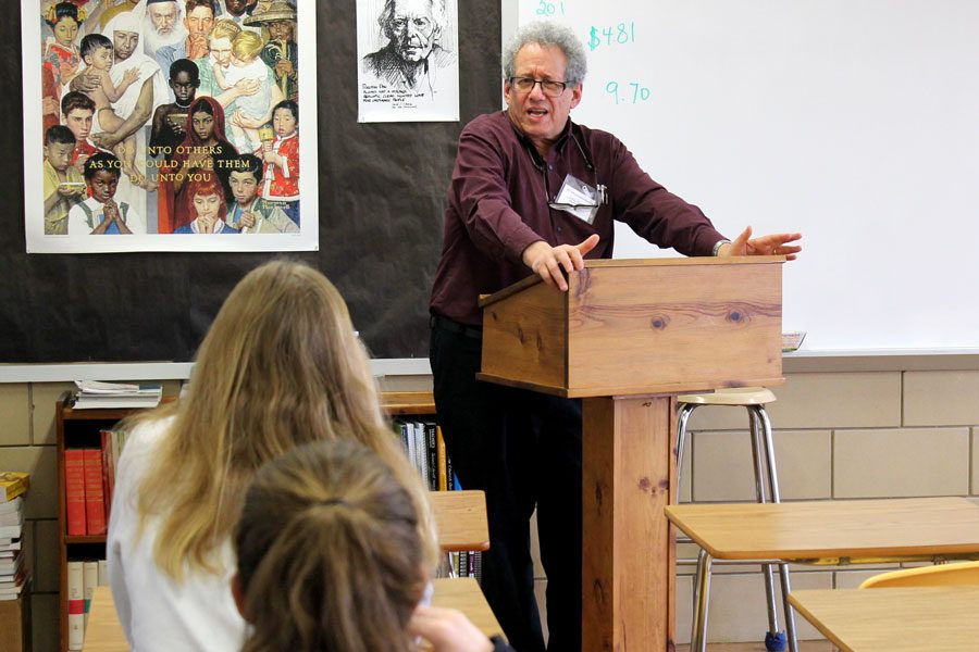 Dr. Steve Salzberg relays the story of his father, a Holocaust survivor, to a classroom of seniors during a small group presentation on Holocaust Remembrance Day on Tuesday, Feb. 28. Holocaust Remembrance Day is an annual event that focuses on the stories of Holocaust survivors and is put together by Senior Project Coordinator Louise Geczy.