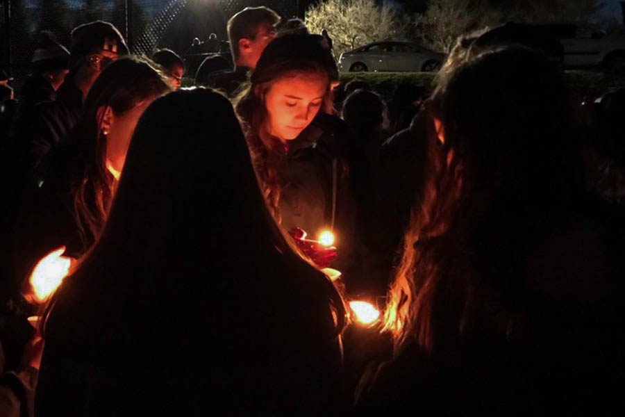 Students huddle together during the candlelight vigil for Josh Hamer on Thursday, March 2. Parents, faculty members, alumni, and members outside of the JC community were also in attendance.