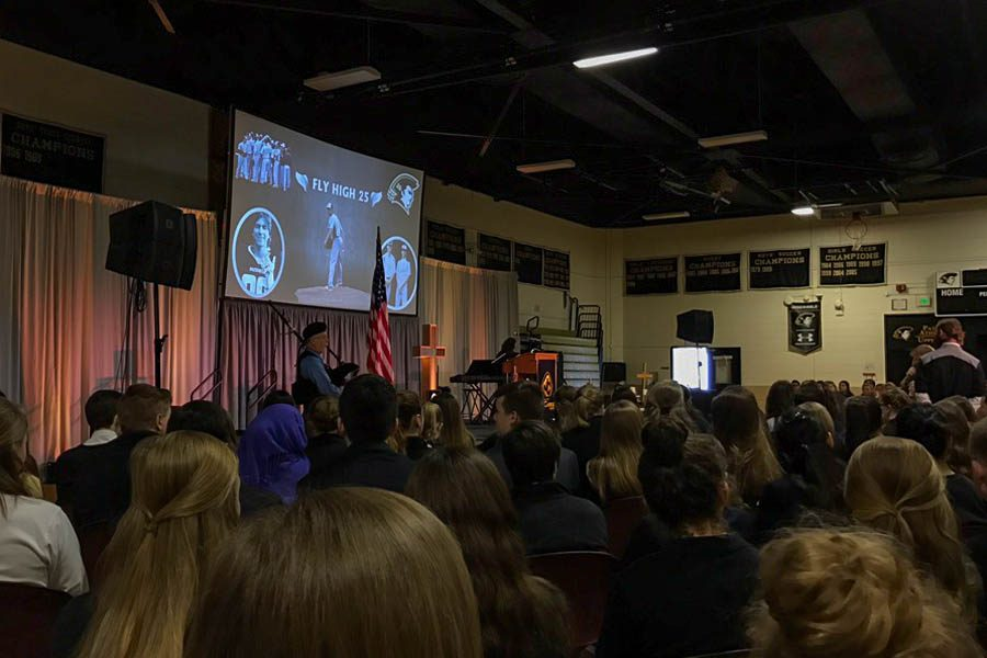John Carroll students and faculty gather in the gym for a prayer service remembering and honoring the life of sophomore Josh Hamer. Hamer's mother, grandmother, and Officer Pfarr of the Harford County Police Department were also in attendance.