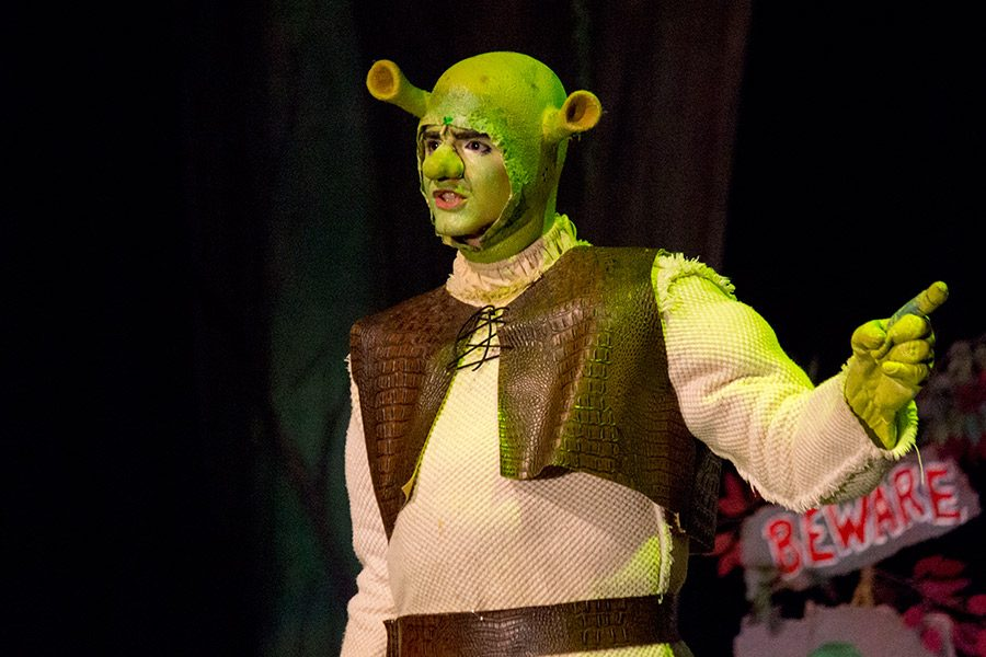 Sophomore Joshua Robinson performing as Shrek, sings the production's opening song