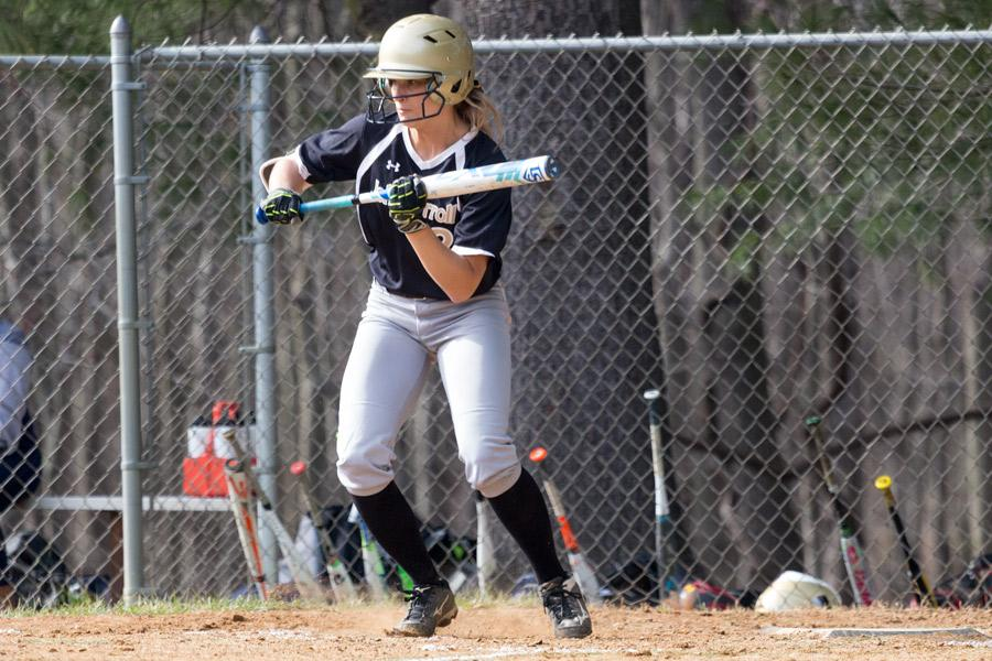 Junior Megan Sheehan prepares to bunt the ball in the softball season-opener against Chapelgate Christian Academy on Tuesday, March 21. The team dominated the game with a final score of 16-0.