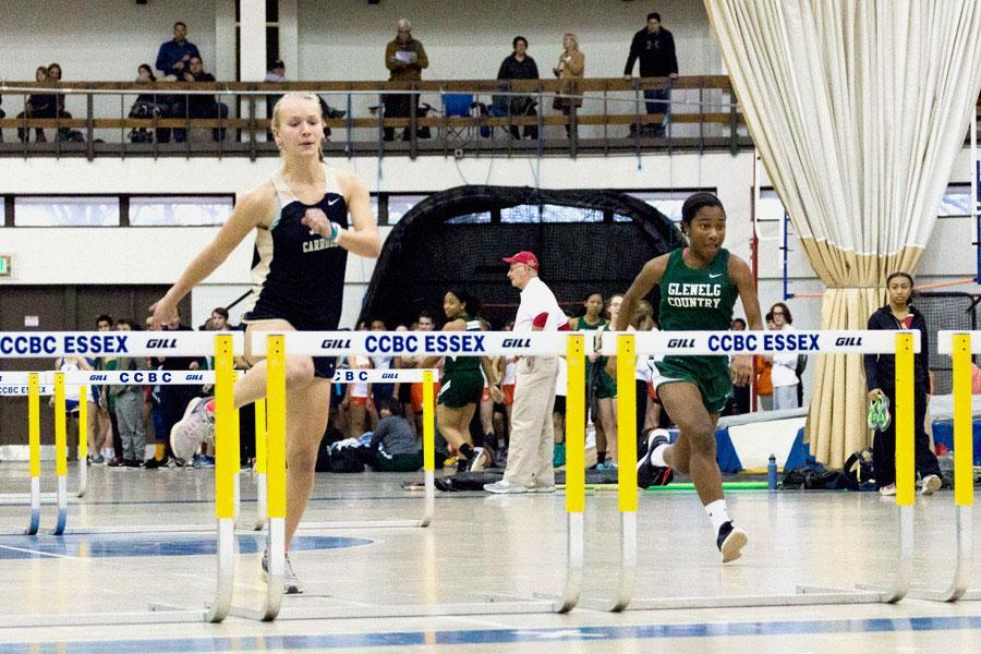 Junior hurdler Ashlee Kothenbeutel approaches the final hurdle to her 50 meter hurdle dash in an IAAM Meet at CCBC on Jan. 13. The women's indoor track and field team finished fourth out of 15 teams in the IAAM A Conference Championships and set several school records.