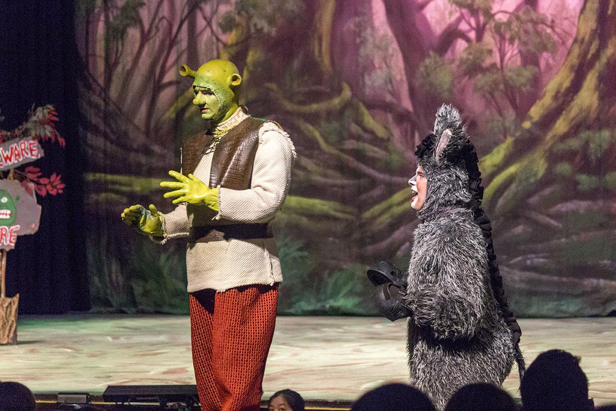 Sophomore Joshua Robinson performs a song on stage as Shrek with Senior Zachary Miller as Donkey in