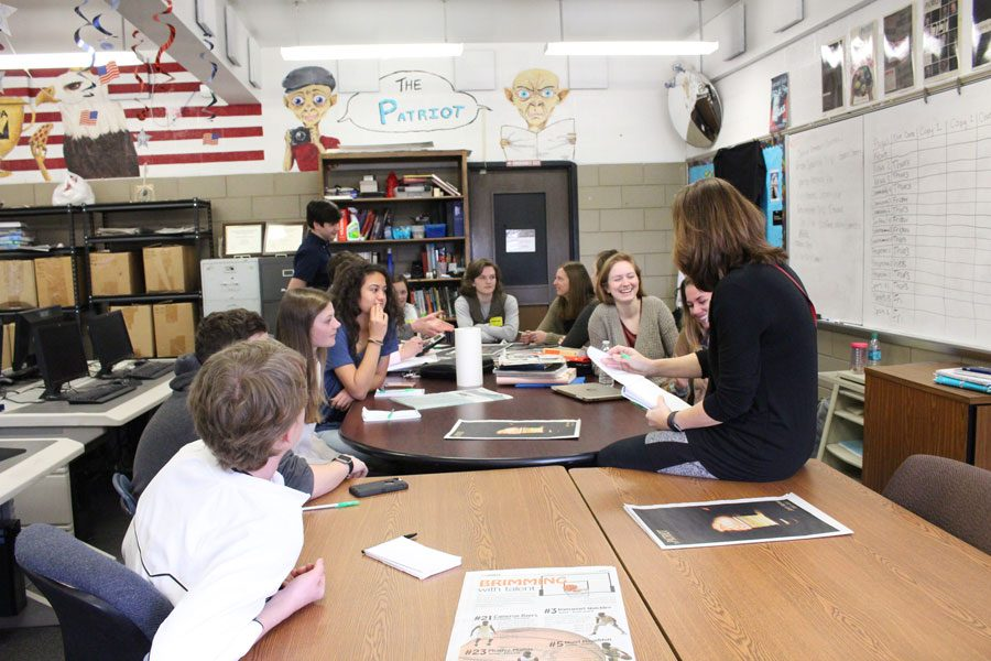 Members of The Patriot and Hereford Harbinger staffs discuss their respective online and print papers. The Hereford High School newspaper staff and members of The Patriot exchanged ideas in order to improve their respective publications.