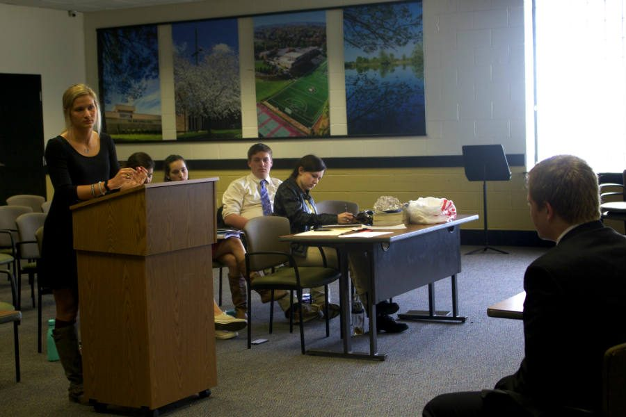 Junior Meghan Sheehan examines junior Ryan Griffin during a mock trial based on the book