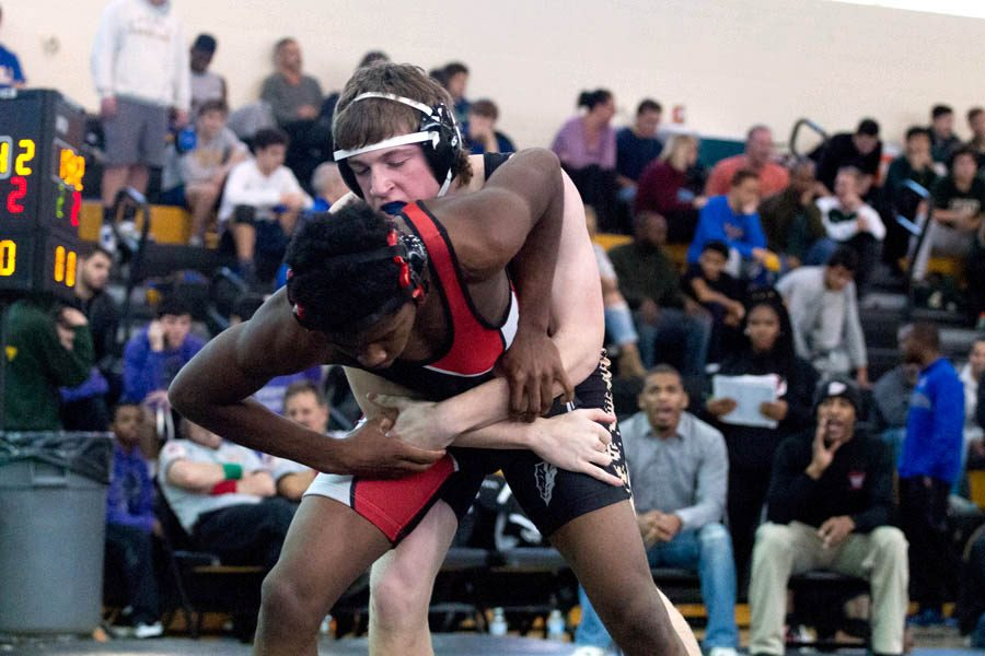 Sophomore Zack Haskell grapples with an opponent from Woodlawn High School in the Parkville Knightmare meet on Dec. 10. The wrestling team finished with a 10-13 dual-meet record.