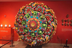 """Featured is a mesmerizing motorized sculpture created by artist Wendy Brackman. The piece is shown in the """"Yummm! The History, Fantasy, and Future of Food"""" exhibit that depicts attitudes toward food supply, production, and consumption."""