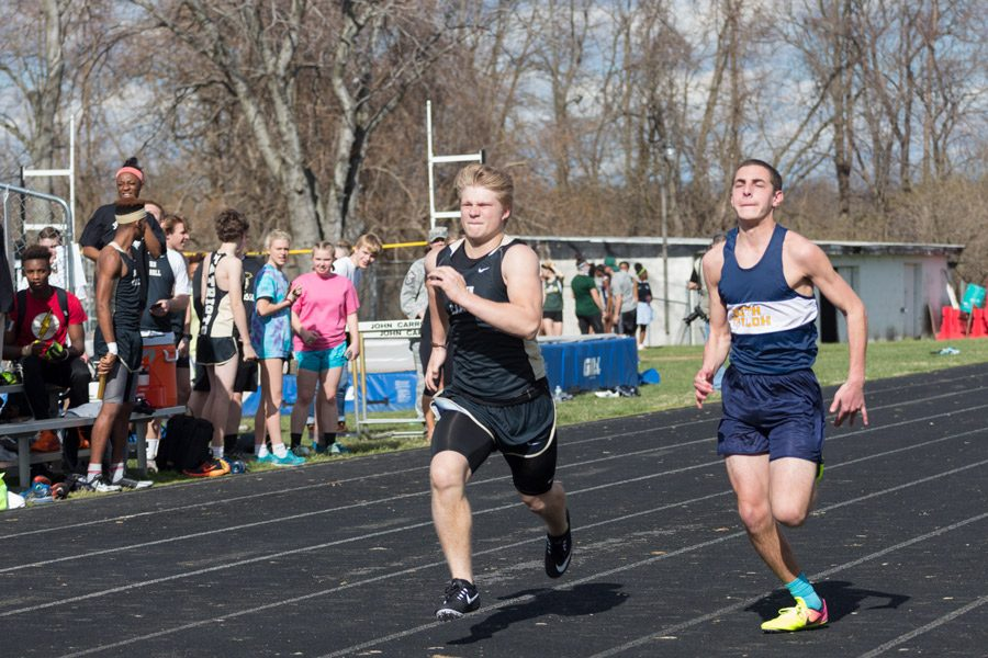 Freshman Nate Slutzky passes an opponent in the 100 meter dash. Slutzky finished with a time of 13.9 seconds.