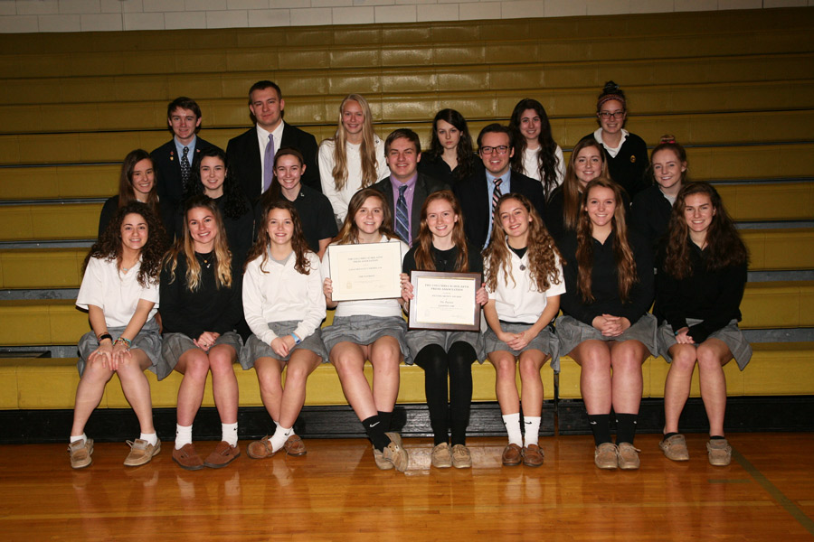 Members of The Patriot staff pose with some of their awards for their yearbook picture. The staff recently was awarded with the NSPA's 2017 Online Pacemaker Award, a Silver Crown from the CSPA, and several Gold Circle Awards.