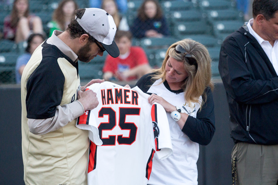 James Hamer and Jen Hamer admire a personalized IronBirds jersey after receiving it during the tribute to their son, Josh Hamer.