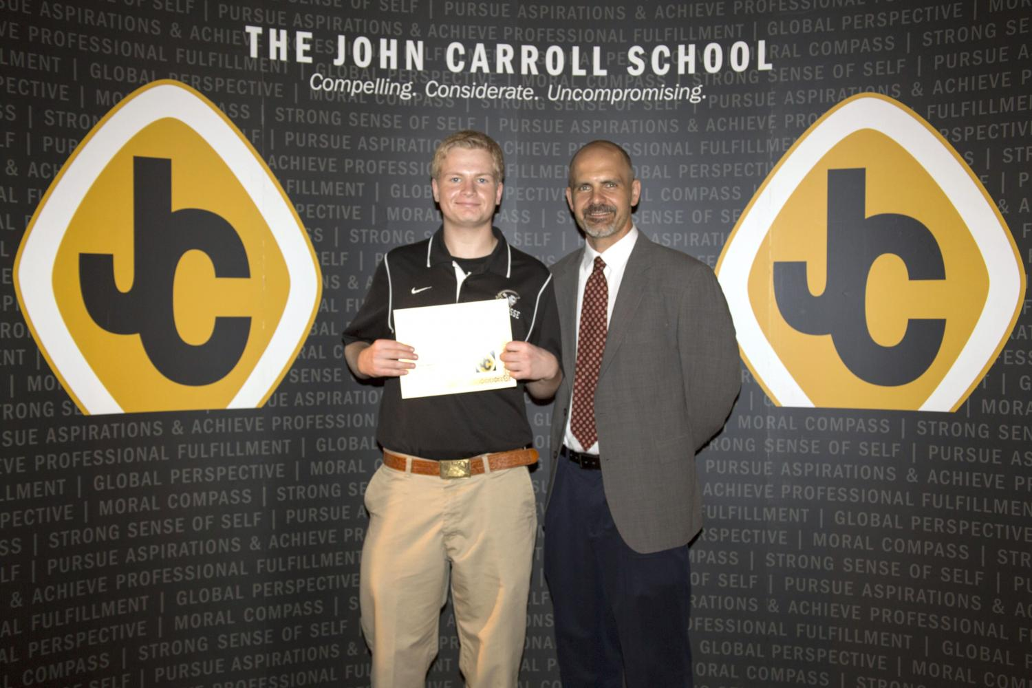 Junior Ryan Griffin was awarded the Jim Chrismer Excellence US History Award by social studies teacher Jake Hollin. Griffin was one of the few juniors honored at the Senior Award Ceremony on May 18.