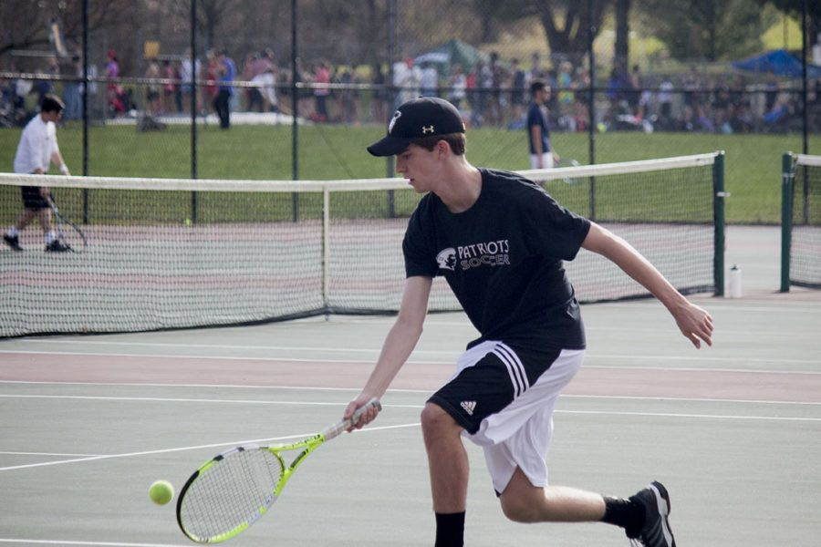 Senior Andrew Kappel reaches for the ball in his doubles match on Tuesday, April 4. Kappel and senior doubles partner Daniel Robinson played against Beth Tfiloh and won 2-1.