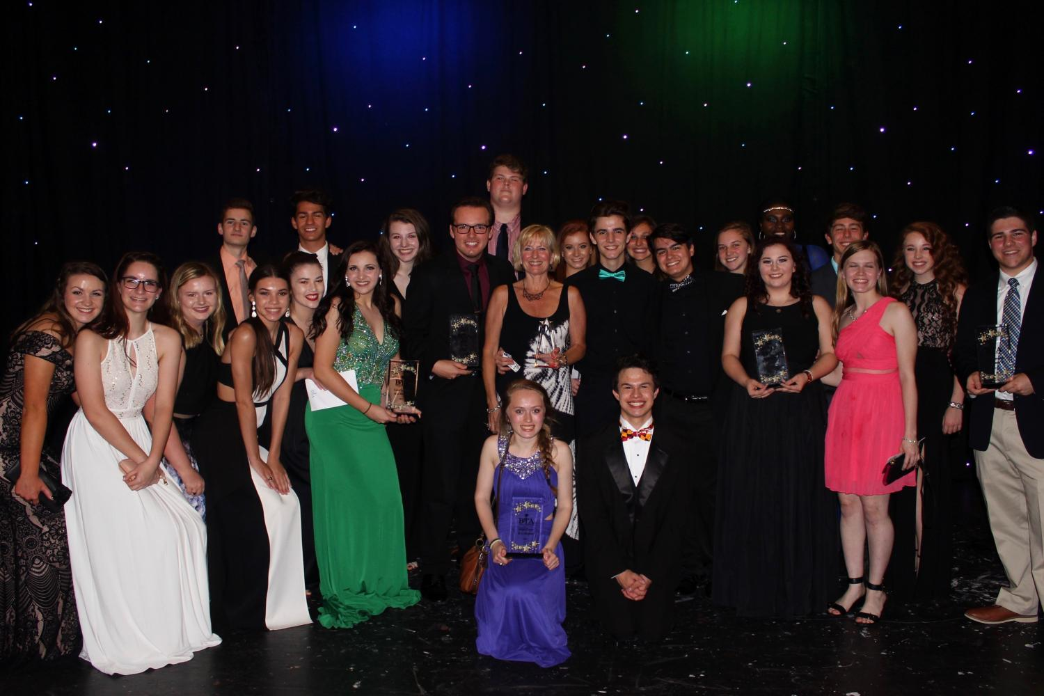 The+cast+and+crew+of+%22Shrek+the+Musical%22+pose+with+their+six+trophies+at+the+Baltimore+Theatre+Awards+on+Sunday%2C+April+30.+The+Theatre+Department+received+several+awards+including+Best+Musical%2C+Best+Ensemble%2C+Best+Student+Orchestra%2C+and+Best+Stage+Crew.+Also%2C+sophomore+Rachel+Miller+won+Best+Leading+Actress+and+senior+Zachary+Miller+won+Best+Supporting+Actor.%0A