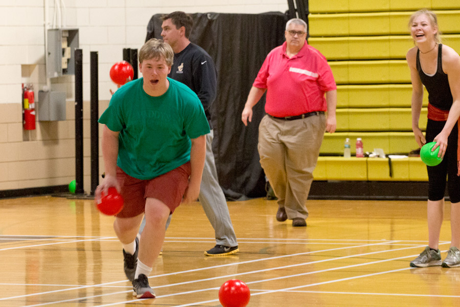Senior Caleb Olsen darts for a ball during a dodge ball game on Field Day, which was held on Friday, May 5. During Field Day, the class of 2017 was divided into separate teams and played a variety of games in the Upper and Lower Gym.