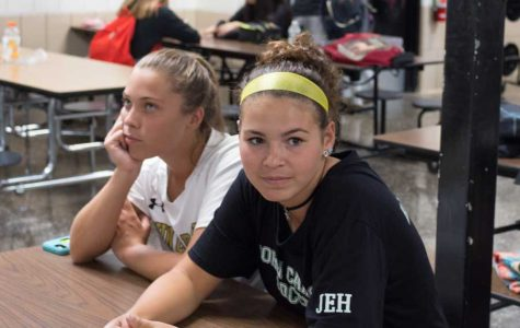 Juniors Mia Katris and Brooke Bleacher wait for soccer practice to begin while their coach is at a faculty meeting. On Aug. 22, the administration announced  that school would end 30 minutes early on D days, rather than starting later in the morning.