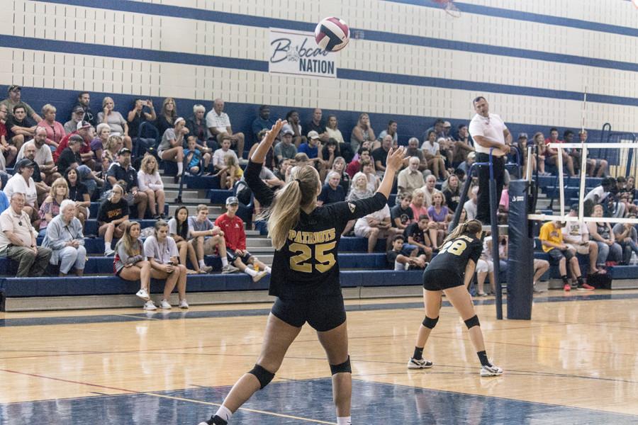 Junior opposite hitter Lauren Golya serves during the womens varsity volleyball match on Saturday, Sept. 16. JC won 3-1.