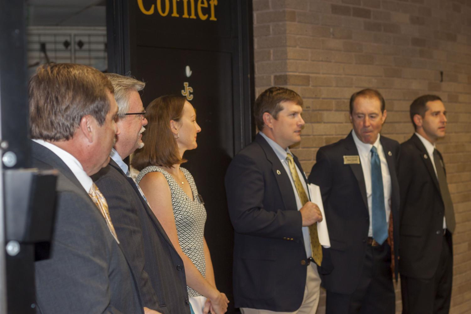 The newly appointed deans line up to greet incoming freshmen and their parents.