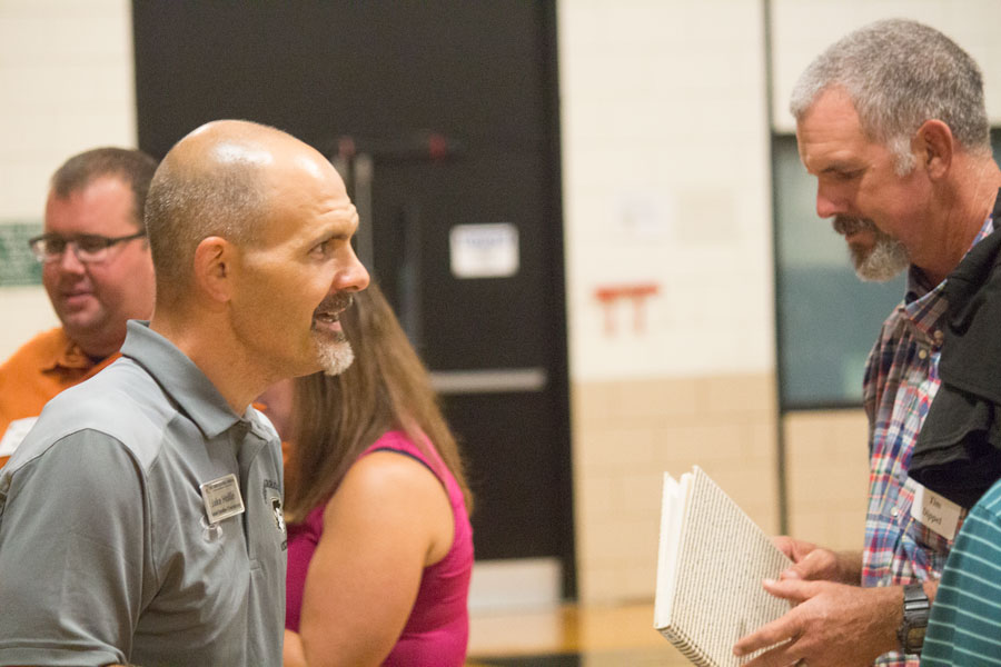 Social studies department chair Jake Hollin greets parents at the freshman/sophomore parent reception. This event was held on Wednesday, Aug. 30 to bring the underclassmen parents together.