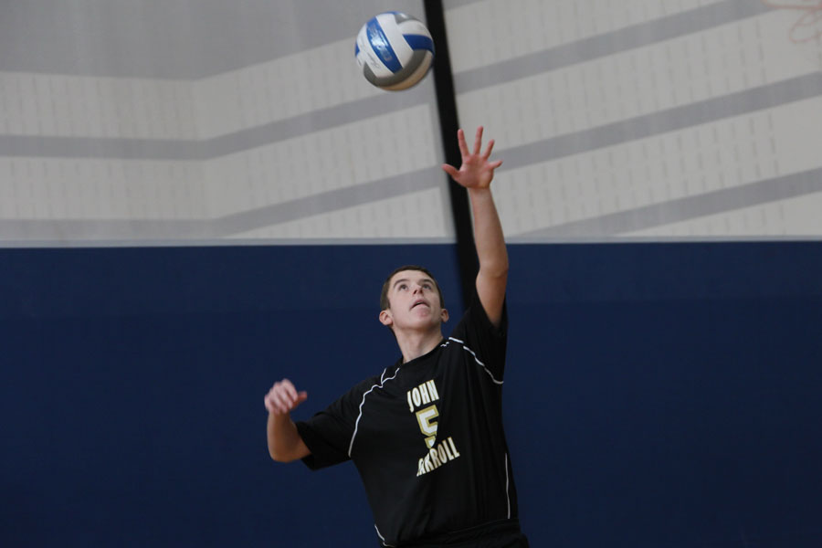 Junior setter Matt Smidt serves during the men's varsity volleyball match on Thursday, Sept. 14.  The men's varsity volleyball team lost to Bel Air 3-0 in the first game of the Commissioner's Cup.