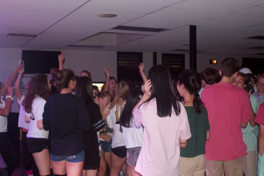 Students enjoy the Back to School Dance last year with their friends in the cafeteria as they celebrate the start of the new school year.  This year, the dance took place on Sept. 9. and has changed over the decades in both size and attire.