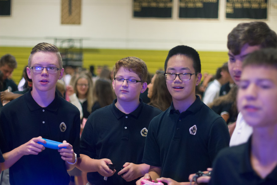 Freshman Hugh Stertzel, Jacob Deaver, Jack Blondell, and Fredrick Dierken play a video game at the Strategic Gaming Clubs table during the Club Fair. The Club Fair was held on Wednesday, Sept. 20, during the D-day community period.