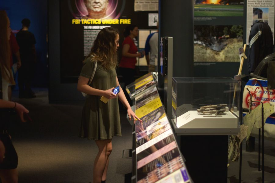Pacificus staff member Sophia Hashim reads one of the descriptions at the Newseum's