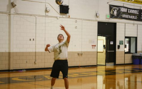 Junior setter Matt Smidt serves the ball in a match against Calvert Hall on Wednesday, Oct. 18. The varsity men's Volleyball team lost to Calvert Hall 3-0.