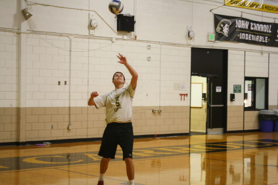 Junior+setter+Matt+Smidt+serves+the+ball+in+a+match+against+Calvert+Hall+on+Wednesday%2C+Oct.+18.+The+varsity+men%27s+Volleyball+team+lost+to+Calvert+Hall+3-0.