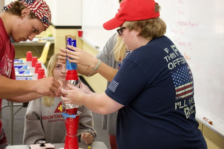Seniors Nathan Druelinger (right) and Brett Raynor (left) construct a tower out of miscellaneous materials in Entrepreneurial Studies. The goal of the project was to teach teamwork and encourage cooperation between students who may or may not know each other.