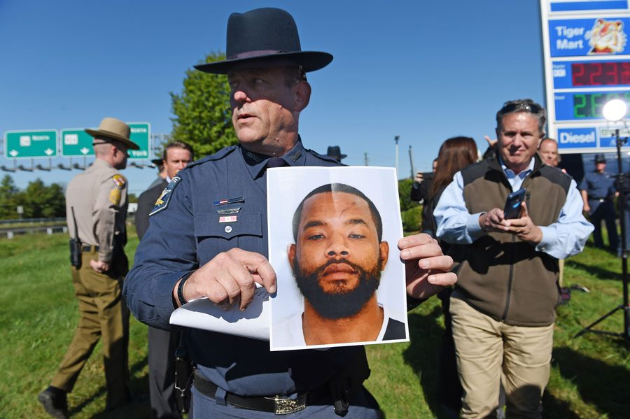 Harford County Sheriff Jeffrey Gahler shows a picture of suspect Radee Labeeb Prince, 37, after a news conference near the scene of a workplace shooting where five people were shot and three are confirmed dead Wednesday, Oct. 18, 2017 in Edgewood, Md. The shooting was at the Advanced Granite Solutions inside Emmorton Business Park.