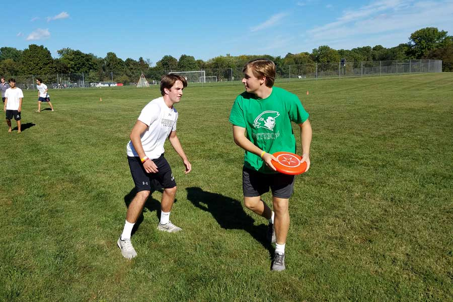 Caption: Junior Will Gianelli covers senior Nick Deloriers as he searches for an open teammate to throw the frisbee to in a competitive game of ultimate frisbee. Both players competed against each other on Friday, Sept. 29. The Ultimate Frisbee Club meets every Friday in the fall. For each session, around 10-15 players come. The Ultimate Frisbee Club is moderated by Shane Lawler and Anthony Del Puppo.