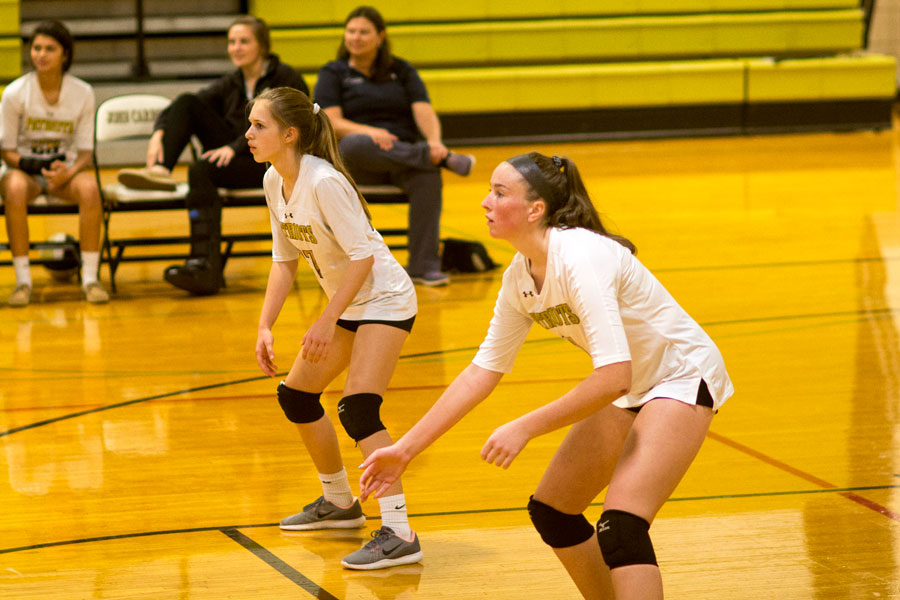 Freshmen Lilly Doud (right) and Marisa Ziegler (left) prepare to pass the serve. On Thursday, Sept. 21 JV lost 2-1 to The Catholic High School of Baltimore and varsity won 3-0.