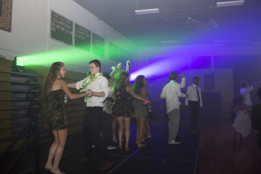 Senior Jim Gorschboth dances with his date on the side stage at the Homecoming Dance on Saturday, Oct. 7. This year's theme was