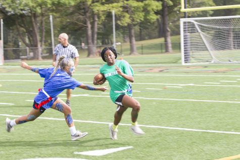 Senior Chika Chuku sprints away from a junior defender during the Powderpuff game on Thursday, Oct. 5. The Powderpuff game occurs every year during Spirit Week between the junior and senior classes.