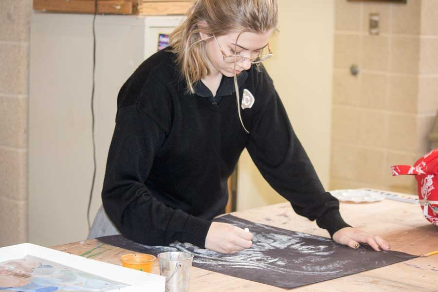 Junior Lauren Wright works on her latest piece of art work, a scary face for Halloween. Wright has been taking art classes since her freshman year and is currently taking Honors Studio 3.