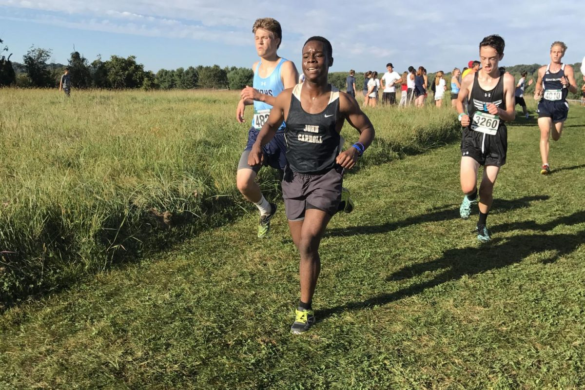 Sophomore Michael Chipi strides up a hill to the finish for the final push of the race. The men's and women's cross country teams competed at the Spiked Shoe Invitational at Stevenson University on Saturday, Sept. 23.