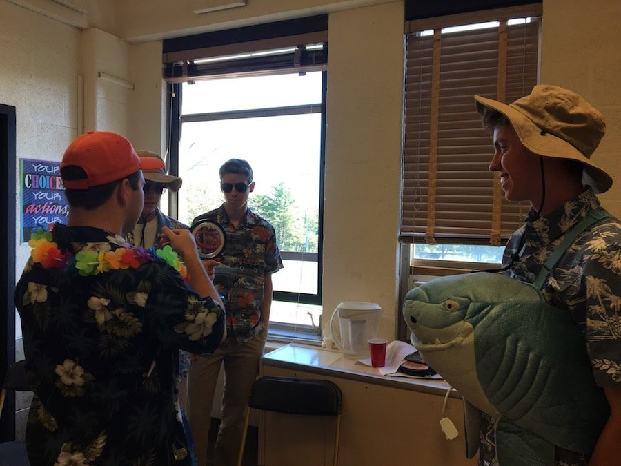 Junior Hunter Currey (right) watches his classmates spin a ring in physics class. Wednesday, Oct. 4 was tropical day during Spirit Week.