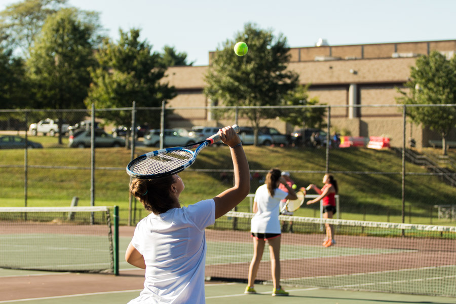 Senior Ellee Perri serves the ball in a tennis doubles match on Tuesday, Oct. 3. JC lost to Friends 5-0.